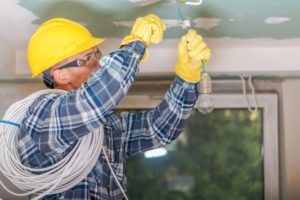camden electrician installing light fitting | Unified Electrical